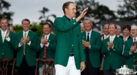 Jordan Spieth waves after being given his green jacket after winning the Masters. (David J. Phillip/AP)