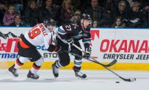 Calvin Thurkauf, right, of the Kelowna Rockets, protects the puck against David Quenneville, left, of the Medicine Hat Tigers. (Marissa Baecker/Kelowna Rockets)
