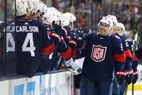 Sep 9, 2016; Columbus, OH, USA; Team USA forward Zach Parise (9) celebrates with teammates on the bench after scoring a goal in the first period against Team Canada during a World Cup of Hockey pre-tournament game at Nationwide Arena. Mandatory Credit: Aaron Doster-USA TODAY Sports